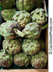 Grocery Store Bin Full of Fresh Green Artichokes - Fresh...