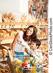 Grocery store shopping - Mother with child
