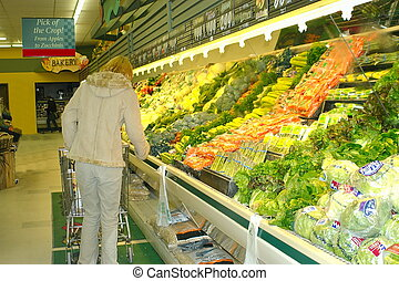 Grocery store - woman shopping at a grocery store.