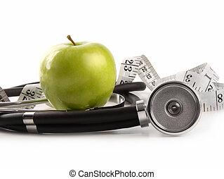 groene appel, en, het meten van band, met, stethoscope, op wit