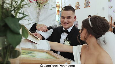 Couple are exchanging vows on their wedding day. Couple of...
