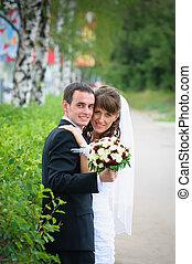 groom and bride embrace. Love tenderness feeling
