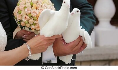Groom And Bride Holding Pigeons