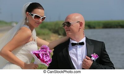 Groom And Bride In Sunglasses Posing At the Nature