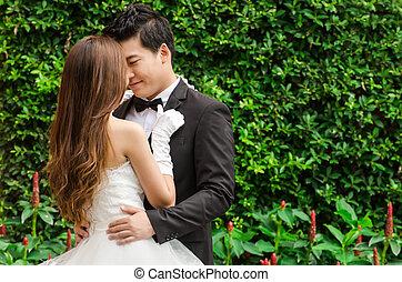 Groom and bride in the beautiful garden