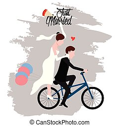 Groom and bride on a bicycle. Just married couple
