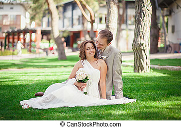 groom and bride on green grass