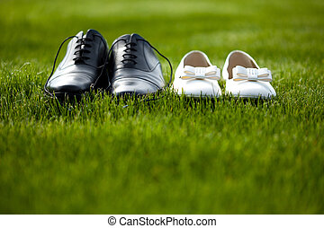 wedding shoes in the grass field - groom and bride wedding ...