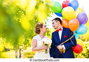 groom and bride with balloons