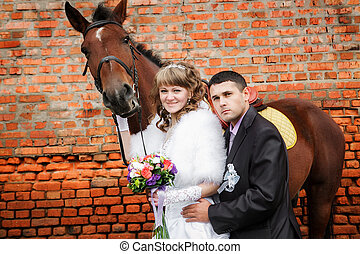 groom and the bride during walk in their wedding day against...