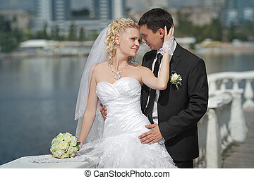 groom and the bride on a beach in their wedding day