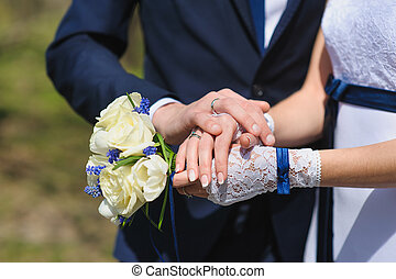 Groom and the bride with a bouquet of roses