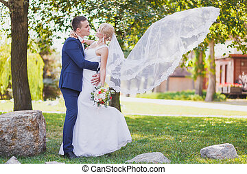 groom, bride, bridal veil flying