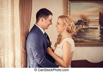 groom embraces the bride - The wedding ceremony beautiful...