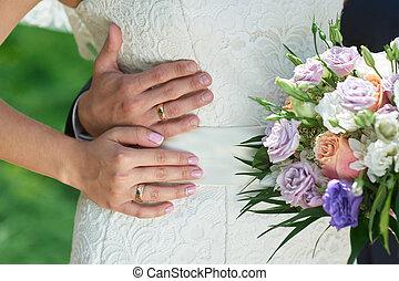 groom embraces the brides waist on a wedding walk