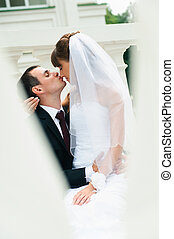 groom embracing bride and kiss nose. Love couple