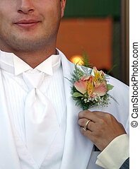 Groom Gets Corsage - Groom being fitted for his corsage ...