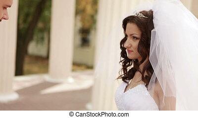Groom goes near bride