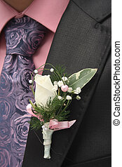 Groom - groom. On the jacket attached flower.