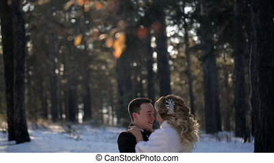 Groom hold bride in his hand and whirling with her outdoor.