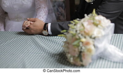 Groom hold the hand of the bride