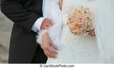Groom Holding Bride By Hand