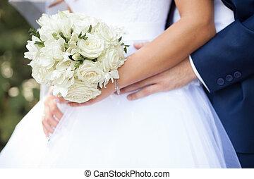 Groom hug the bride