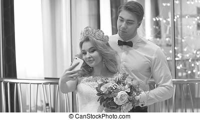 Groom Hugging Bride, Wedding. Black and White Frame