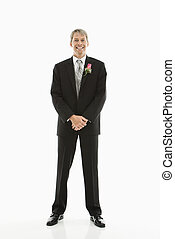 Groom in tuxedo. - Portrait of Caucasian male in tuxedo with...