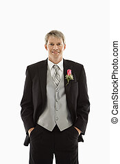 Groom in tuxedo. - Portrait of Caucasian male in tuxedo.