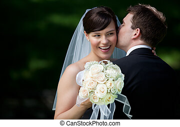 Groom Kissing Bride on Ear