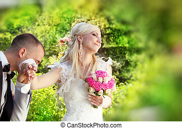 groom kissing hand of female bride.