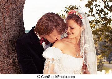 groom kissing her bride