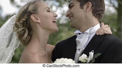 Groom kissing his pretty new wife i