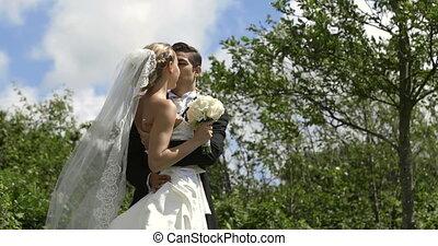 Groom kissing his pretty new wife o