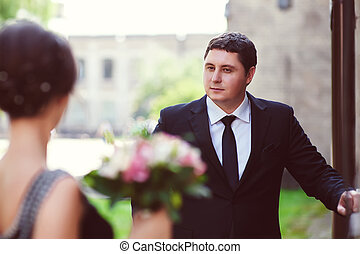 groom looking at the bride. Toned image
