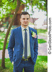 groom on nature portrait wedding summer