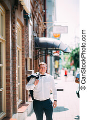 groom on the background of a city street