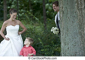 Groom playing hide and seek with his son - pictures shooten...
