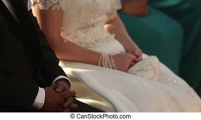 groom sit next to bride