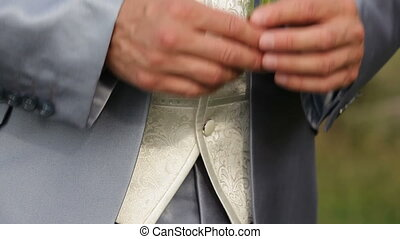 Groom slipping off daisies