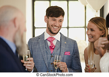 Groom Socialising With His Wedding Guests