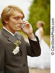 Groom speaks by phone , forgotten about bride - The groom...