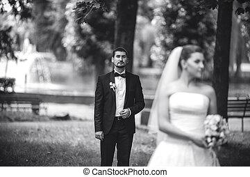 groom standing behind the bride