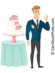 Groom standing near cake with glass of champagne.