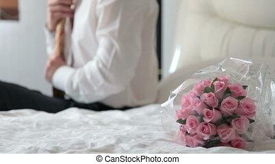 groom tying his tie