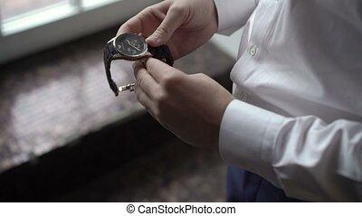 Groom wearing wrist watches closeup