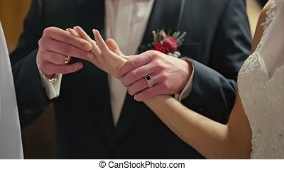 Groom Wears Wedding Ring on Woman's Hand Bride Ceremony...