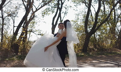Groom whirl his bride keeping her o