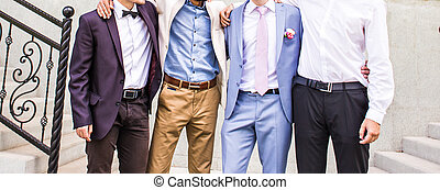 Groom With Best Man And Groomsmen At Wedding